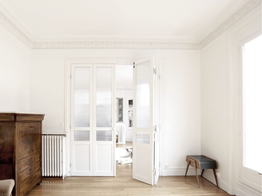 half opened folding door in apartment salon vintage funiture